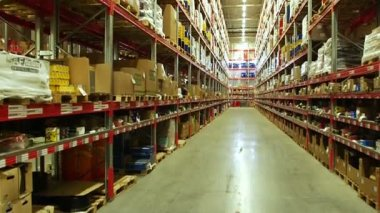 Shelves of boxes inside a storage warehouse. — Stock Video