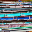 Постер, плакат: Parked colorful row boats