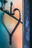 Reflection of handle of the heart-shaped balcony — Stock Photo