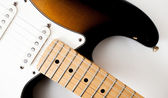Detail of electric guitar neck and body — Stock Photo