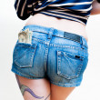 Sexy woman body part model with dollars in short jeans — Stock Photo #63216911