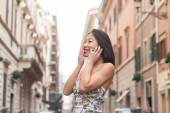 Young beautiful asian woman smiling using mobile phone spring ur — Stock Photo