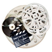 Movie clapper and different cinema film reel isolated on white — Stock Photo