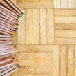 Ring of pencil with wooden body on parquet background — Stock Photo #78514066