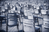 Multitude of empty chair on road pavement — Stock Photo
