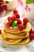 Pancakes with fresh raspberries and creamy soft cheese. — Stock Photo