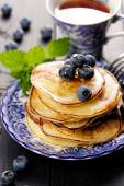 Pancakes with addition of fresh blueberries — Stock Photo