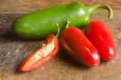 Red and green jalapenos — Stok fotoğraf