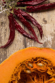 Sugar Pumpkin With Chili Peppers — Stock Photo