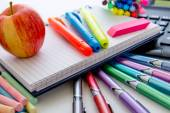 Back to school supplies and an apple for the teacher — Stock Photo