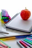 Back to school supplies and an apple for the teacher — Stok fotoğraf