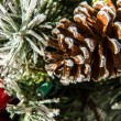 Christmas decorations, ornaments and pine cone — Stock Photo #55984065