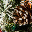 Christmas decorations, ornaments and pine cone — Stock Photo #55984067