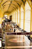 Passengers walking through a bright airport — Stock Photo
