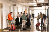 Passengers waiting in the corridor for a flight — Stock Photo