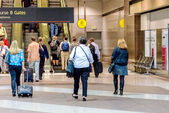 People waiting for the terminal tram at DIA — Stock Photo