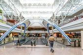 Daylighting roof structure with people walking and people movers — Stock Photo