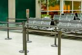 Empty airport seating - typical black chairs in boarding waiting — Stock Photo