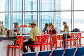 People seated at restaurant bar in an airport — Stock Photo