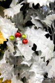 Christmas decorations - silver Poinsettia with red and green ber — Stock Photo