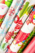 Christmas decorations - rolls of wrapping paper — Stock Photo
