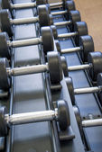 Indoor fitness equipment - free weights stacked on the rack — Stock Photo