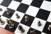 Chess game - silver pieces lined up for start — Stock Photo