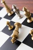 Chess game - fallen gold king on chessboard — Stockfoto