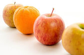 Line of apples with one orange — Stock Photo