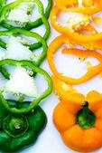 Green, orange bell pepper slices — Foto Stock