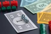 February 8, 2015: Houston, TX, USA.  Monopoly car, money, hotels — Zdjęcie stockowe