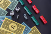 February 8, 2015: Houston, TX, USA.  Monopoly money, playing pie — Stock fotografie