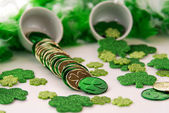 Saint Patrick's Day - coins and shamrocks — Stock Photo