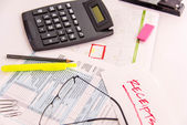 Tax preparation supplies, reading glasses and tax forms — Stock Photo
