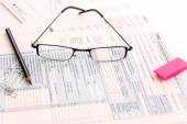 Tax preparation supplies, reading glasses and tax forms — Stockfoto