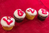 Valentines Day - cupcakes spelling LOVE — Stock Photo