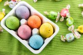 Colored Easter eggs in a white carton — Stock Photo