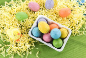 Colored Easter eggs and yellow chicks — Stock Photo