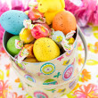 Easter bucket with colored eggs, candy and yellow chicks — Stock Photo #67721191