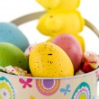 Easter bucket with colored eggs, candy and yellow chicks — Stock Photo #67721321