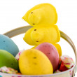 Easter bucket with colored eggs, candy and yellow chicks — Stock Photo #67721343