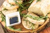 Fresh baked resomary bread loaf and olive oil and balsamic vineg — Stock Photo