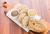 A fresh baked loaf of whole grains bread — Stock Photo