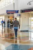 DFW airport - passengers in the Skylink station  — Stock Photo