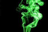 Green smoke on black background — Stock Photo