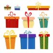 Set of gift boxes in different colors on a white background — Stock Vector #62637529