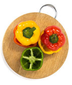 Paprika of different color on a board — Stock fotografie