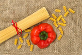 Pasta on canvas with red pepper — Stock Photo