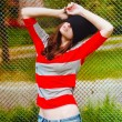 Portrait of a beautiful hipster girl in hat and striped jacket — Stock Photo #54914103