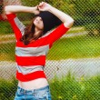 Portrait of a beautiful hipster girl in hat and striped jacket — Stock Photo #54914105